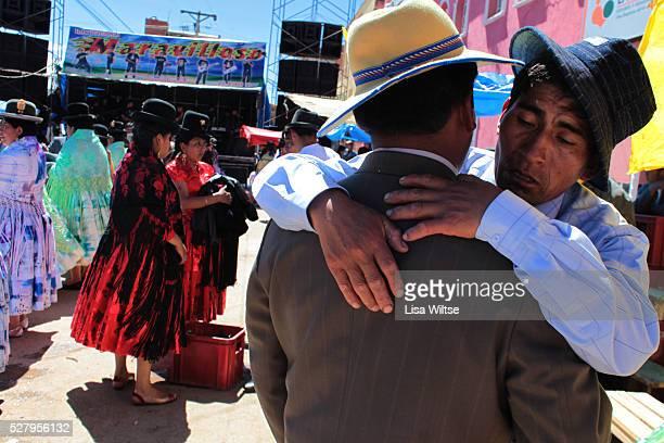 Virgen de la Candelaria Drunken men embrace each other during the Fiesta de la Virgen de la Candelaria is held to honour the Virgen or the Dark...