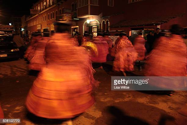 Virgen del la Candelaria Aymaran women dance into the night during the Fiesta de la Virgen de la Candelaria is held to honour the Virgen or the Dark...