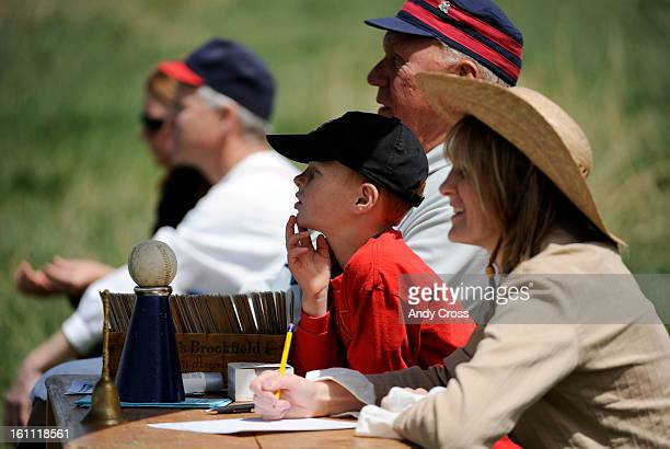 COMAY 8TH 2010Young Griffin Hill 6yearsold keeps an eye on the action as he assists scorekeeper Rachel Morris right during the Colorado Vintage...