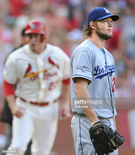 Dodgers Clayton Kershaw looks towards the scoreboard as Cardinals David Reese scores a run on the 5th innng in game 2 of the NLCS in St Louis Saturday