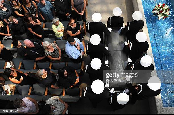 Pall bearers carry the casket of fallen firefighter Kevin Woyjeck during a funeral service at the Crystal Cathedral in Garden Grove Tuesday. Woyjeck...