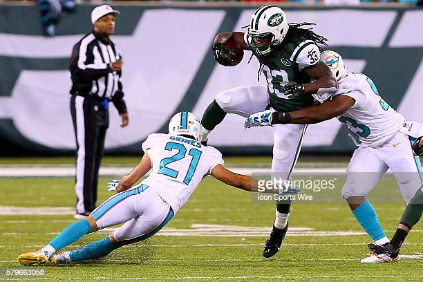 New York Jets running back Chris Ivory hurdles Miami Dolphins cornerback Brent Grimes during the second quarter of the Monday Night Football game...