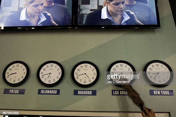HOLLYWOOD CA MAY 9 2014Someone changes the prop clocks in the newsroom set of the fictionalized Atlantis Cable News on HBO's The Newsroom from...