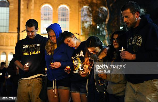 Students gather at UCLA near Royce Hall to pay tribute to the Isla Vista victims during a candle light vigil Moday