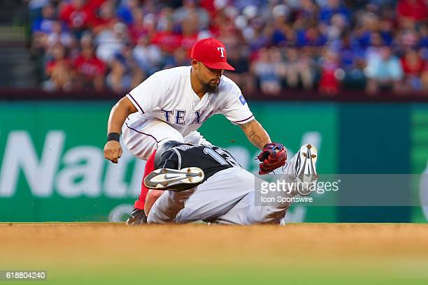 Colorado Rockies Center field Charlie Blackmon [8056] dives in under a tag by Texas Rangers Second base Rougned Odor [9855] during the MLB game...