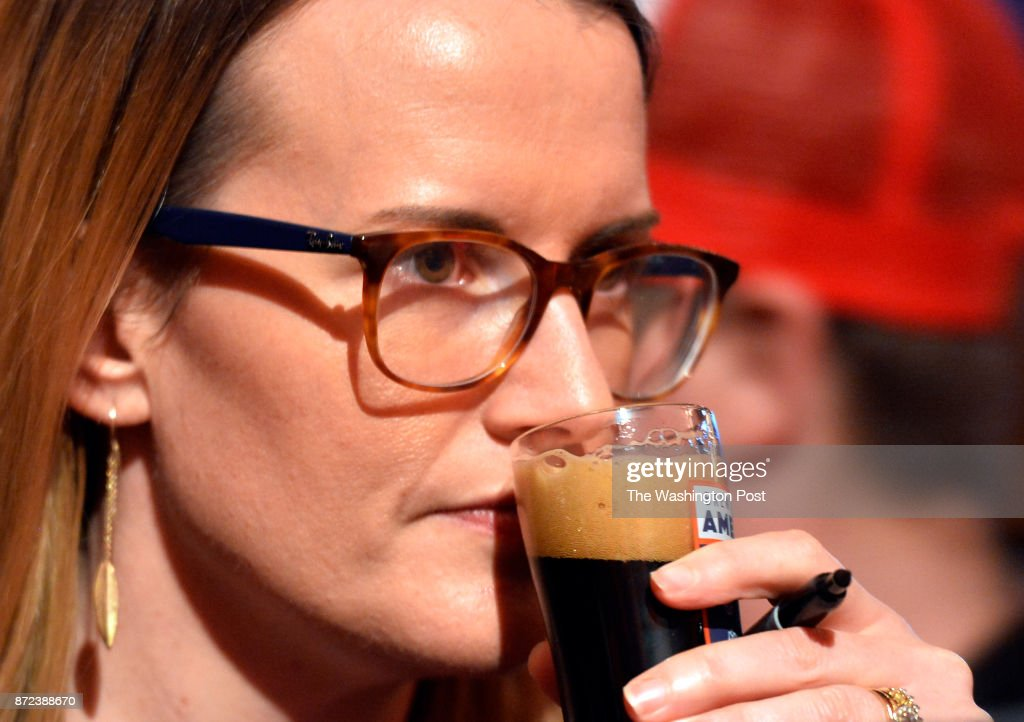 Beer judge Susan Davis checked the aroma of Loudermilk's Star and Stouts, named after named after Congressman Barry Loudermilk from Georgia, at the Brew Across America Congressional Beer Competition held at the Eastern Market on November 08, 2017 in Washington, D.C. Nine members of Congress with help from local breweries brewed their own beer that was judged by a panel of local media personalities.