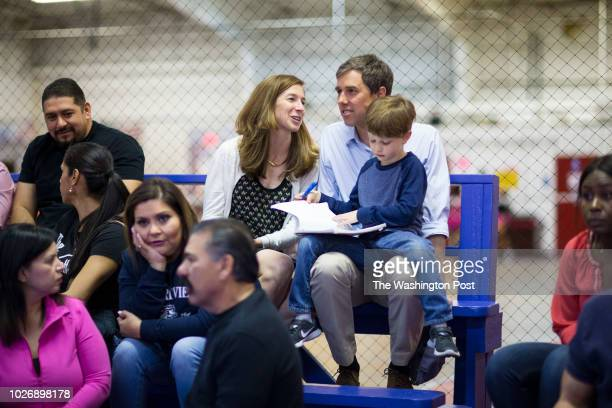Beto O'Rourke and wife Amy Hoover Sanders O'Rourke watch their daughter during her volleyball game as their son Ulysses does homework Friday February...