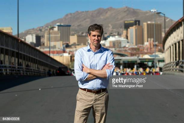 Beto O'Rourke stands for a portrait in the middle of the international bridge between the US and Mexico Friday February 10 in El Paso Texas