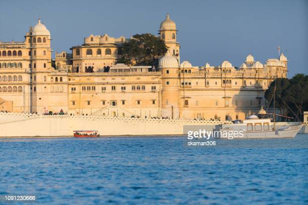 UDAIPUR, RAJASTHAN, INDIA - 2018/December/26 tourist boat sightseeing  around Pichola lake near udaipur palace Udaipur india