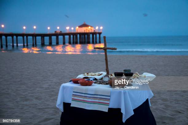CA SUNDAY APRIL 01 2018The The Manhattan Beach Pier as a background a table with items used for celebration of Mass before an Easter sunrise service...