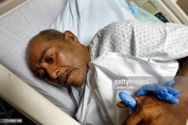 Luis Florez already suffered from cirrhosis before he contracted COVID19 putting him at added risk He holds on to a nurse as he received treatment at...