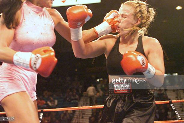 Mia St John lands a knockout punch on Sherri Thompson at the MGM Grand Garden Arena in Las Vegas Nevada DIGITAL IMAGE Mandatory Credit Tom...