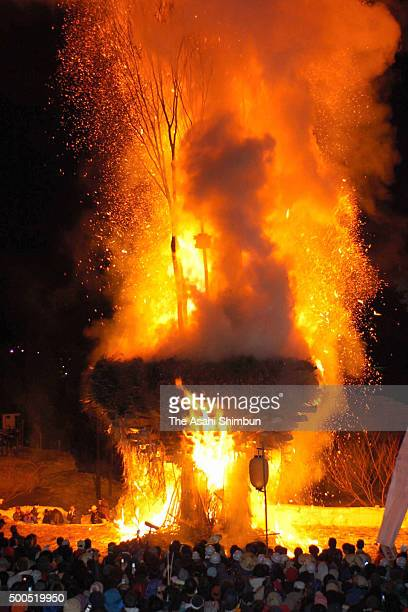A 20metretall makeshift shrine hall is ablaze during the Dosojin Fire Festival on January 15 2006 in Nozawaonsen Nagano Japan