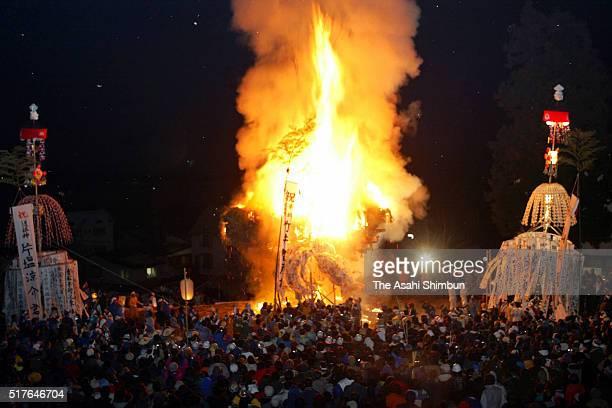 A 20metretall makeshift shrine hall is ablaze during the Dosojin Fire Festival on January 15 2002 in Nozawaonsen Nagano Japan