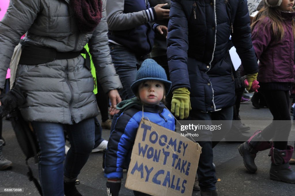 20-months old Luke van Orden, with parents Melinda and James van Orden, of Philadelphia, PA, participate in peaceful and family friendly protest during the February 4th, 2017 March for Humanity, in Center City Philadelphia, Pennsylvania.
