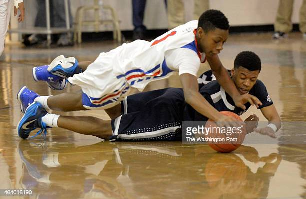 Sherwood's Chris West and Magruder's David Garey dive to the floor for a loose ball in the first half on February 20 2015 in Olney Md