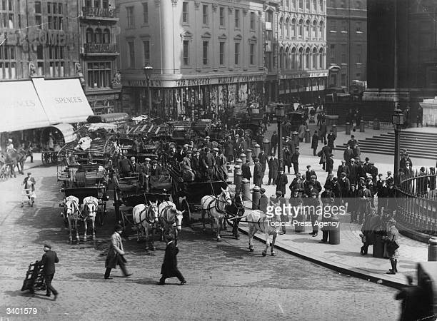A London street brought to a stand still by a crowd of horse drawn cabs as northern football fans travel to Crystal Palace to watch the FA Cup final...