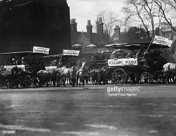 Football supporters on horse-drawn buses in London for the FA Cup Final between Barnsley and West Bromwich Albion.