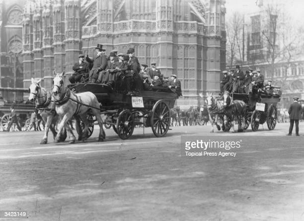 Football supporters on horsedrawn buses visiting London for the FA Cup Final between Barnsley and West Bromwich Albion