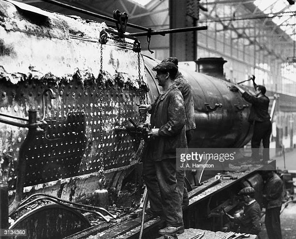 Employees of GWR at Swindon servicing a 'King' class locomotive
