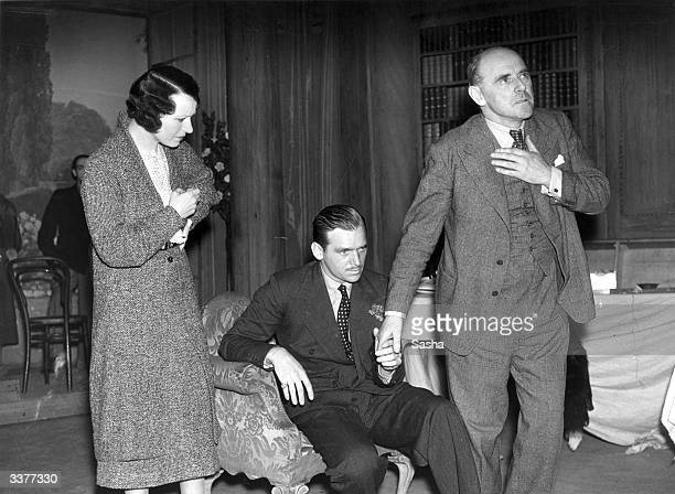 Actors Joyce Kennedy and Douglas Fairbanks Junior and Producer Lewis Casson during a rehearsal of the play 'Winding Journey'
