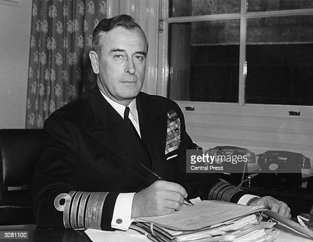 Admiral the Earl Mountbatten as first Sea Lord at his desk at the Admiralty office