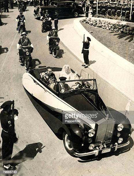 20th April 1956 Prince Rainer of Monaco and his bride Princess Grace tour their postagestamp Principality after their glittering religious wedding...