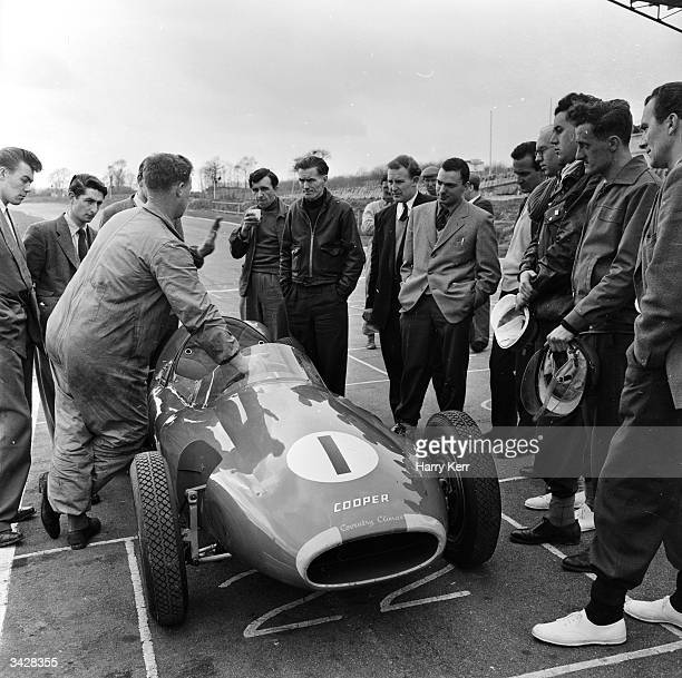 Pupils receive instruction from an instructor employed by the Racing Drivers Training Division of the Cooper Car Company on the Brands Hatch circuit