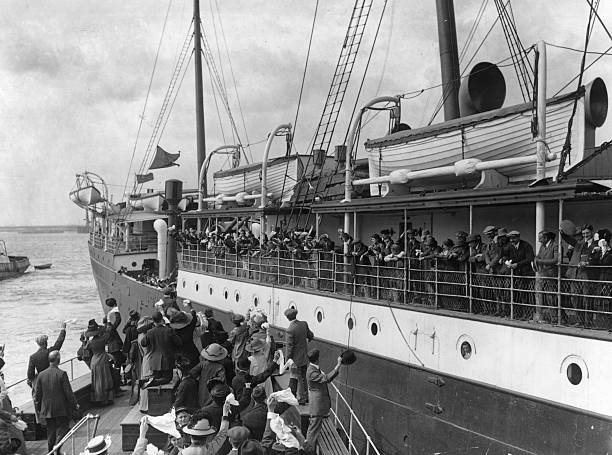 Emigrants wave their last goodbyes as the emigrant...
