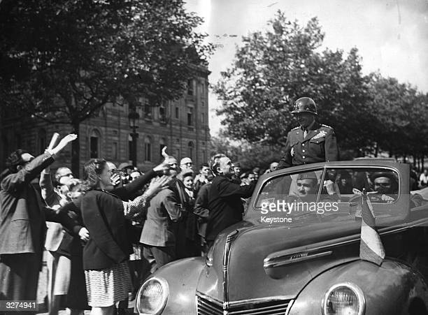 General George Smith Patton also known as 'Old Blood And Guts' an American General in command of the US 3rd Army in North Europe He is being welcomed...