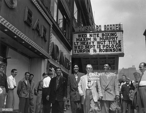 British boxer and World Middleweight Champion Randolph Turpin with his manager and brothers Dick and Jackie in New York