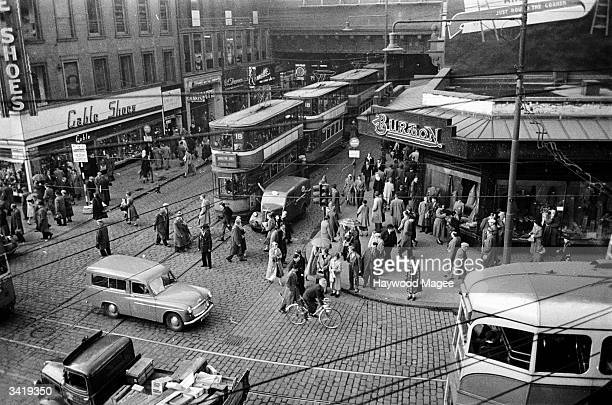 A line of trams emerges from the shelter of Heilanman's Umbrella in Glasgow where Argyle Street passes under Central Station and dissects Union...