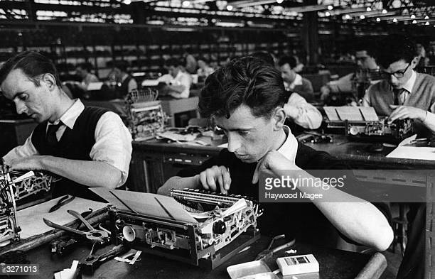 Employees of British Olivetti Ltd testing typewriters at the company's factory on the Queenslie Industrial Estate in Clydeside Glasgow The factory is...