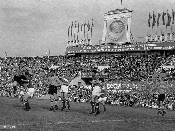 Wolverhampton Wanderers players Roy Swinburne Jimmy Mullen and Dennis Wilshaw attack the opposition's goal as Wolves play Spartak Moscow in Moscow...