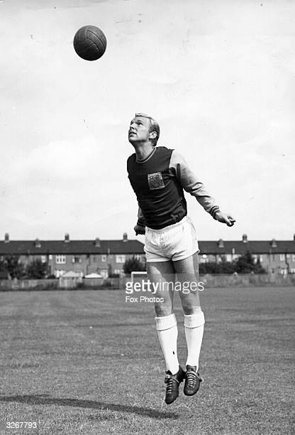 Bobby Moore captain of West Ham United and England heads the ball during a training session at the Allen and Hanbury ground Chadwell Heath Essex