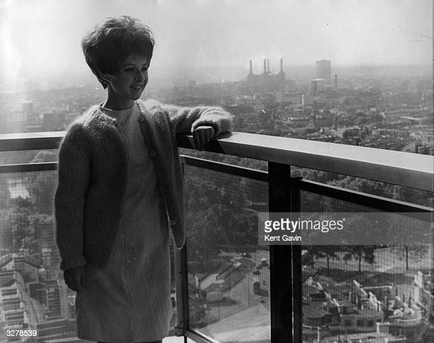 American pop star Brenda Lee admires the view from her Hilton Hotel apartment during a trip to London for recording and TV appearances Battersea...