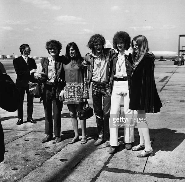 The three piece British rock group Cream From left to right Jack Bruce Ginger Baker and Eric Clapton with girlfriends at London Airport Amongst them...