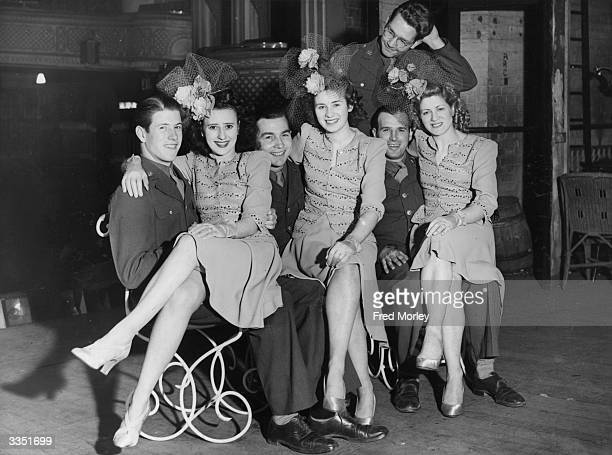 Chorus girls taking a break from the show 'Something For The Boys' with some genuine American GIs at the Winter Garden Theatre Glasgow