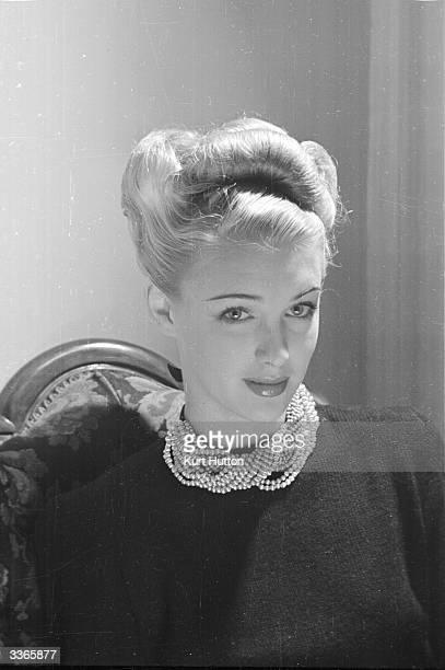 The English actress Susan Shaw models a handknitted black woollen jumper adorned with a large choker Original Publication Picture Post 4482...
