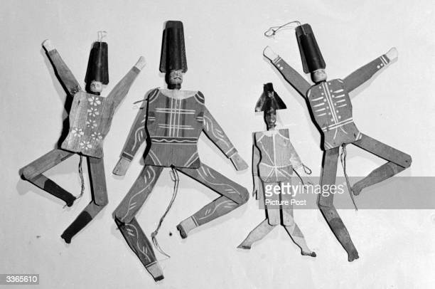 Wooden puppets made by Walter Trier, illustrator of children's books and magazines. Original Publication: Picture Post - 4488 - Trier And His Toys -...
