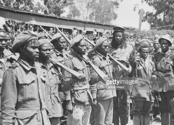 Field Marshal Mwariama inspects his troops at a Mau Mau hideout in Meruland