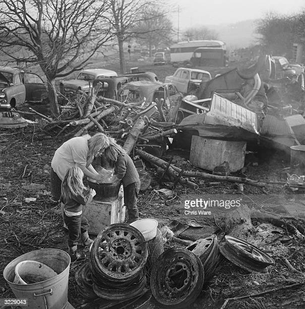 A group of gypsies wash their hands amidst the squalor of their camp site in Orpington Kent