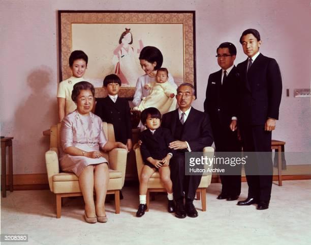 Portrait of Emperor Hirohito and Empress Nagako posing with their children and grandchildren LR Crown Prince Akihito Prince Hitachi Emperor Hirohito...