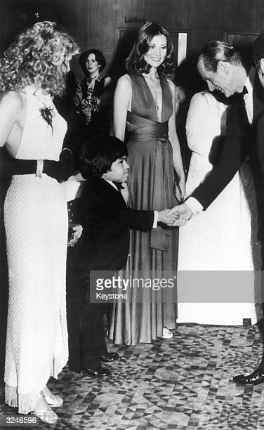 French actor Herve Villechaize welcomes Prince Philip to the premiere of the James Bond film 'The Man with the Golden Gun' at the Odeon Leicester...