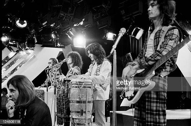 T Rex and Elton John perform on BBC TV show Top Of The Pops London Christmas 1971 LR Bill Legend Elton John Marc Bolan Mickey Finn Steve Currie