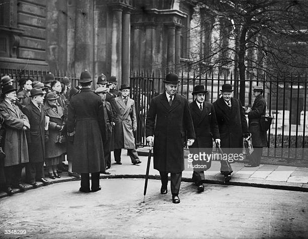 Arriving for a cabinet meeting following the resignation of Foreign Secretary Anthony Eden are Sir Thomas Walter Hobart Inskip later 1st Viscount...