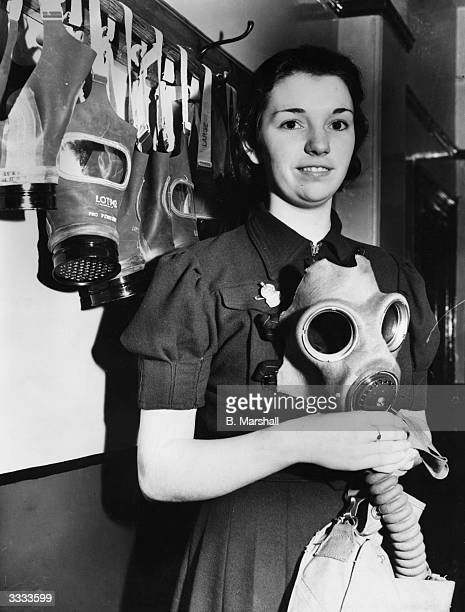 Jennie Dawson recently chosen as ARP Queen of three mining villages in Yorkshire with various gas masks As titleholder she will host various social...