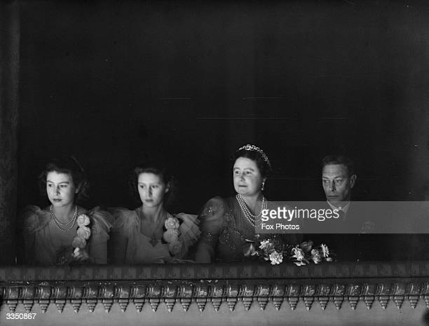 King George VI and Queen Elizabeth accompanied by the two Princesses in the royal box for the reopening of the Royal Opera House Covent Garden London...