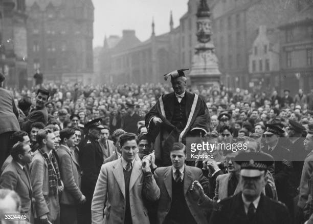 British bacteriologist and Nobel laureate Sir Alexander Fleming is chaired by students from McEwan Hall after being installed as Rector of Edinburgh...