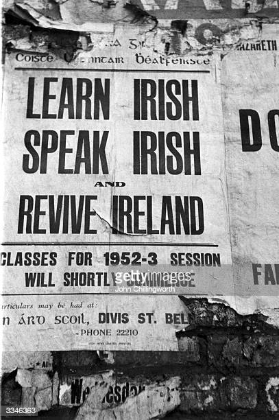 A poster advertising lessons in the Irish language on a wall in Belfast Northern Ireland Original Publication Picture Post 7029 The Best And The...